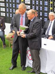 Winner Richard Latham receives the trophy from England Golf's Immediate Past President Nigel Evans O.B.E.